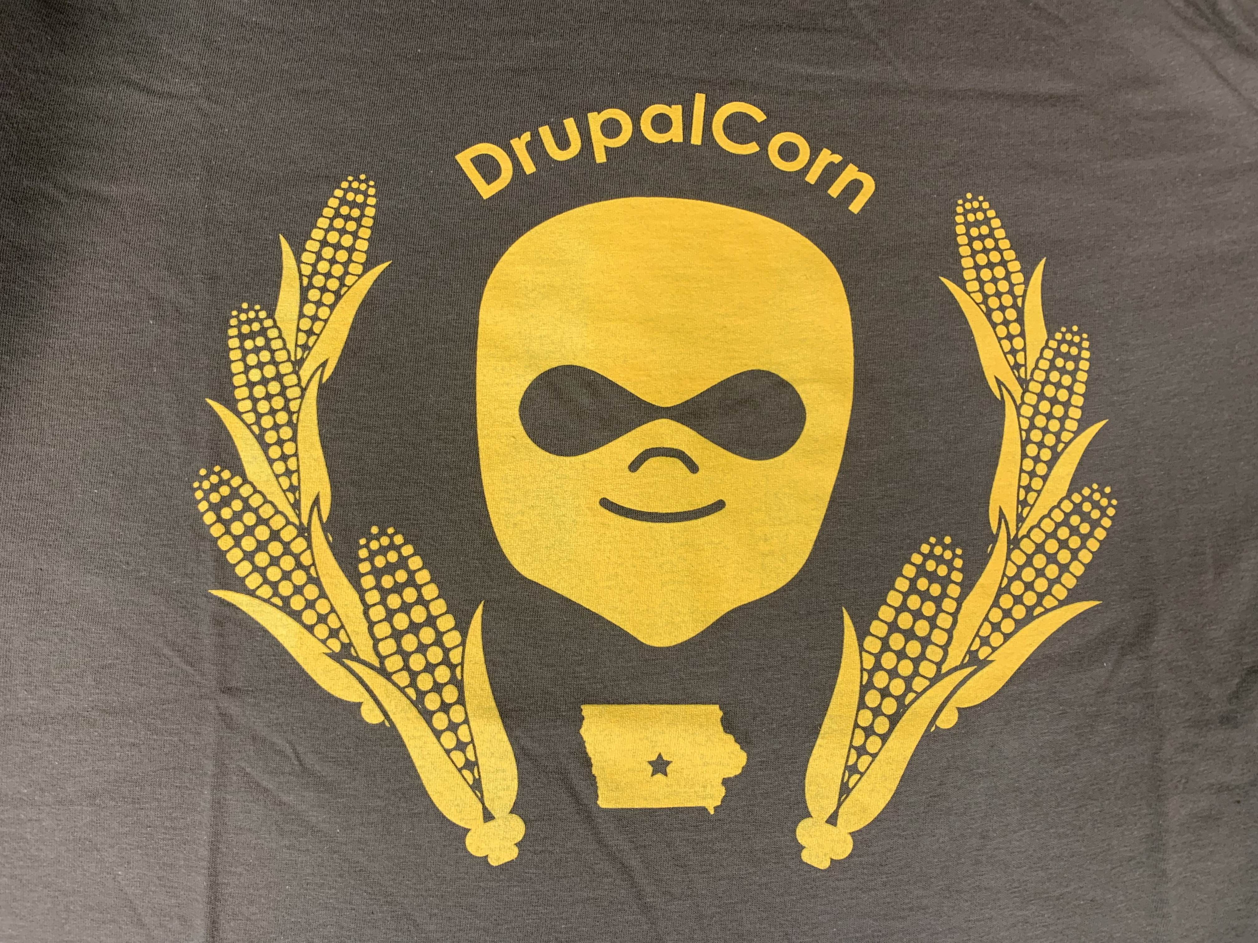 2018 DrupalCorn Shirt - Brown with yellow lines.