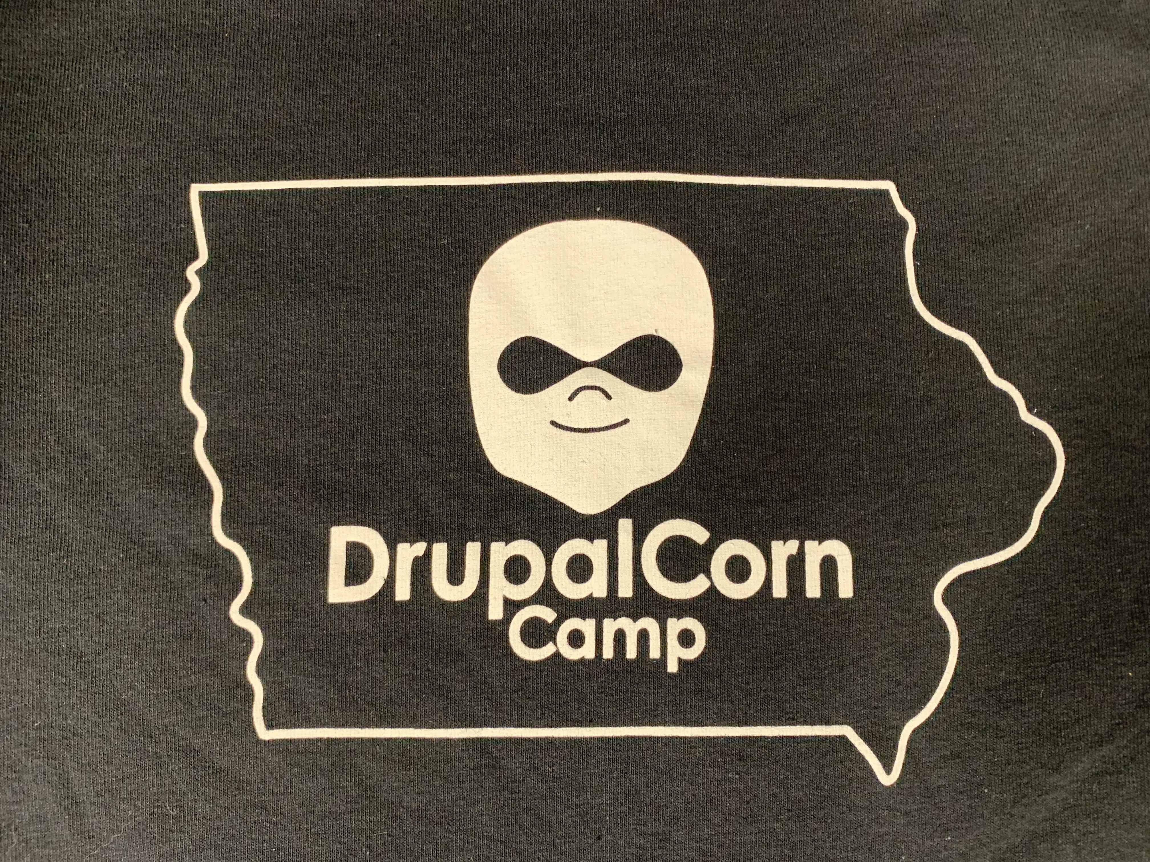 2019 DrupalCorn Shirt - Black with White lines. Outline of the state of Iowa with DrupalCorn Logo in the middle and text 'DrupalCorn'
